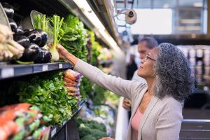 Woman getting Healthy vegetables at a store looking for good nutrition